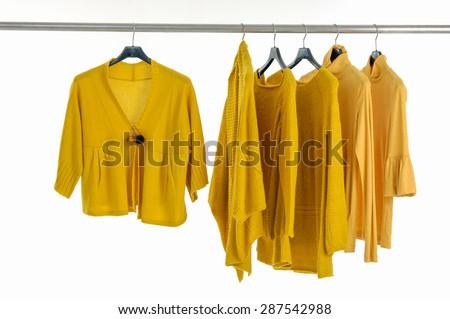 female yellow clothing on hangers - stock photo