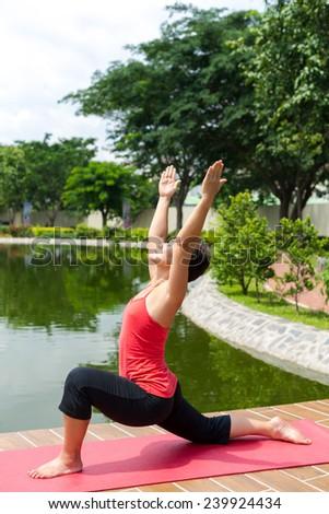 Female yoga instructor doing exercises - stock photo