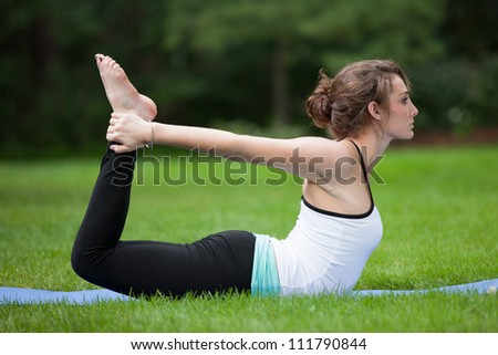 Female Yoga Practice  at Outdoor Park Flexible Pose