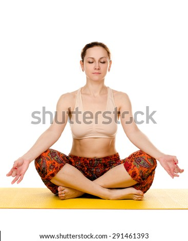 female yogi practising yoga exercises on yellow mat isolated on white background