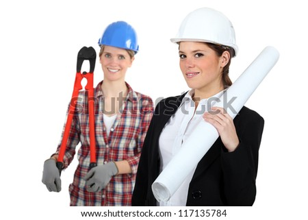 Females construction workers - stock photo