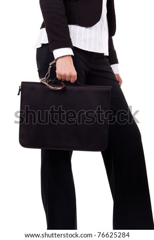 females hand with handcuff and a suitcase, isolated on white - stock photo