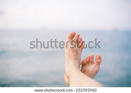 femalw feet on the beach. Freedom concept - stock photo