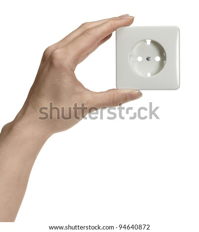feminine hand holding a white socket in front of white back