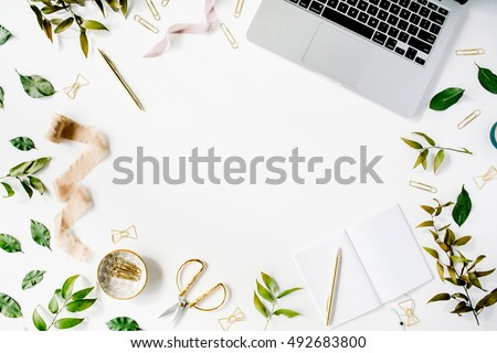 feminine home office workspace with laptop notebook and accessories flat lay top view
