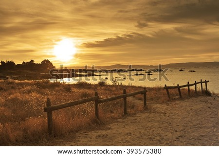Fence and dune at sunset on the beach Espineiro