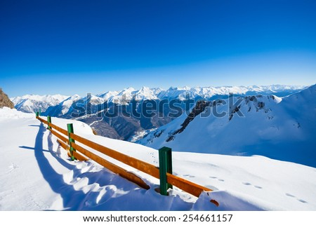 Fence and mountain panorama on winter ski resort