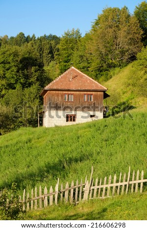 fence and rural house, Serbia - stock photo
