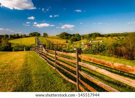 Fence and view of rolling hills and farmland in Antietam National Battlefield, Maryland (Horizontal). - stock photo