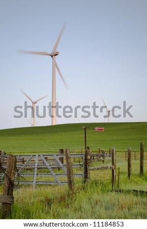 fence field and windmills