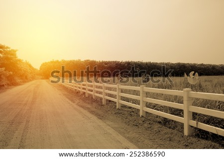 Fence in farm field. Vintage filter - stock photo
