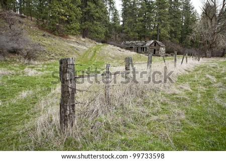 Fence in pasture. - stock photo