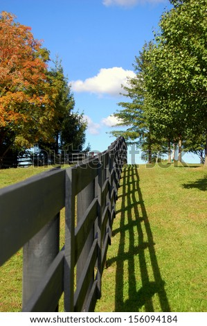 fence in perspective country landscape - stock photo