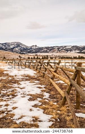 Fence leading your eyes toward the sleeping giant near Helena, Montana - stock photo