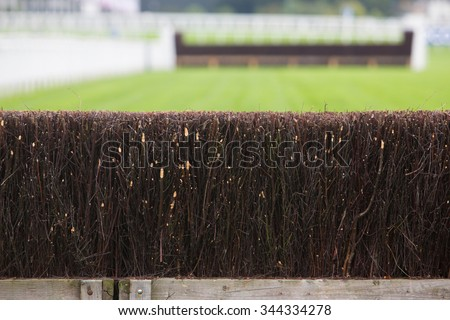 Fence On Horse Racing Track - stock photo