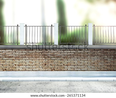 fence on the background of the park - stock photo