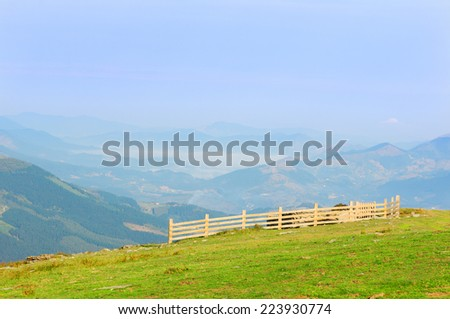 fence on the mountain on sunny day - stock photo