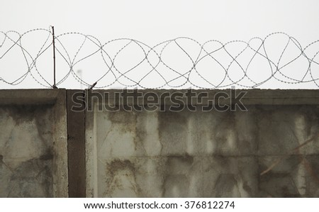 fence with barbed wire - stock photo