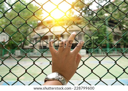 Fence with left hand and Beam light of sun