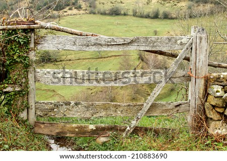Fence wooden door in a meadow in Asturias, Spain - stock photo