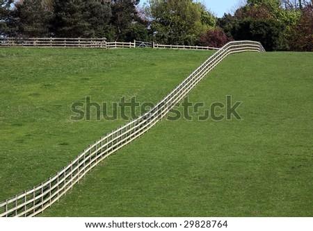 fenced fields - stock photo