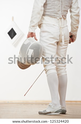 fencer in protective sport wear with mask and rapier foil at training - stock photo