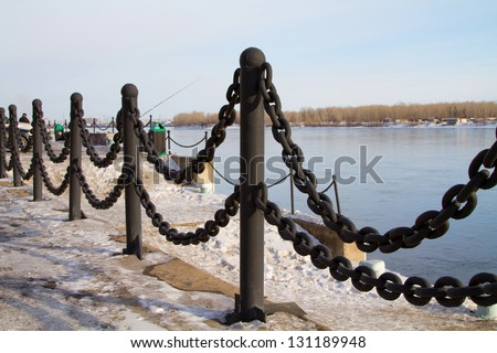 Fencing of the chains on the waterfront in the city of Krasnoyarsk - stock photo