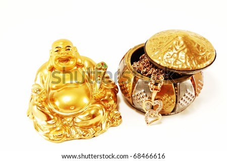 Feng Shui. God of wealth and gold jewelry isolated on white background