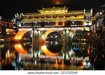 Fenghuang (Phoenix) ancient town at night, Hunan province, China - stock photo