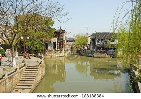 FENGJING, SHANGHAI, CHINA - MARCH 17: famous village spot named three bridges. The ancient village is a Shanghai tourist attraction with 100,000 visitors per year. March 17, 2010, Fengjing, China.