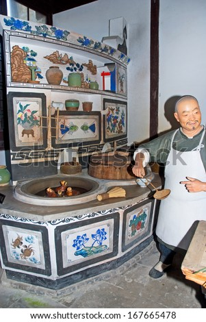 FENGJING, SHANGHAI, CHINA - MARCH 17:  old Chinese kitchen. The ancient village is a Shanghai tourist attraction with 100000 visitors per year. March 17, 2010, Fengjing, China. - stock photo