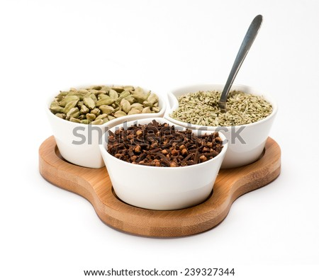 Fennel seed Cardamoms and Cloves in white bowl isolated on white background - stock photo