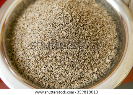 Fennel seeds selling in spice market. Focus pointed at the center and shallow DOF. - stock photo
