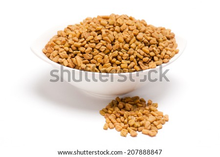 Fenugreek seeds in white bowl isolated on white background