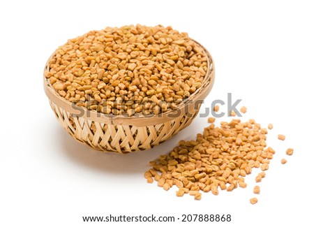 Fenugreek seeds in wooden basket isolated on white background