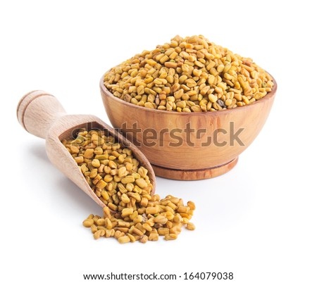 fenugreek seeds isolated on white background - stock photo