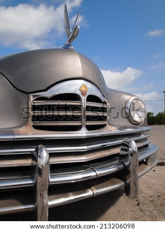 FENWICK ISLAND, DELAWARE - AUGUST 23, 2014: A vintage Packard automobile with swan hood ornament is on display in a parking lot. - stock photo