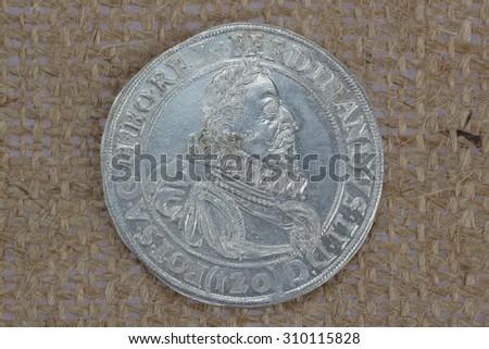 Ferdinando old taler silver coins background - stock photo