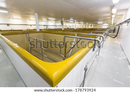 fermentation pools in an old brewery plant - stock photo