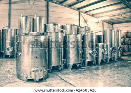 Fermentation stainless steel vats in a winery, toned - stock photo