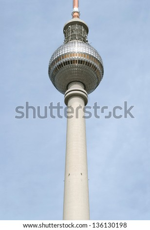 Fernsehturm or TV Tower Berlin at Alexander Place, one of German landmarks, on blue sky background