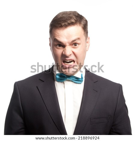 Ferocious guy shows his teeth, isolated - stock photo
