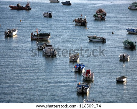 FERRAGUDO, PORTUGAL - OCT 19: Small fishing boats float anchored along the waters of the Arade River on October 19, 2012 in Ferragudo, Portugal.