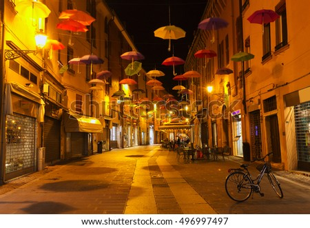Ferrara, Italy - 7 September, 2016: One of the famous streets of Ferrara at night. People love to walk here.