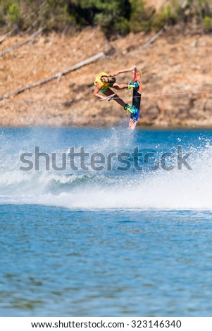 FERREIRA DO ZEZERE, PORTUGAL - SEPTEMBER 19, 2015: Dallas Friday (USA) during the WWA Supra World Wakeboard Championship 2015 in Ferreira do Zezere, Portugal.