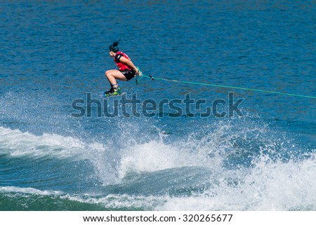 FERREIRA DO ZEZERE, PORTUGAL - SEPTEMBER 19, 2015: Raimi Merritt (USA) during the WWA Supra World Wakeboard Championship 2015 in Ferreira do Zezere, Portugal.