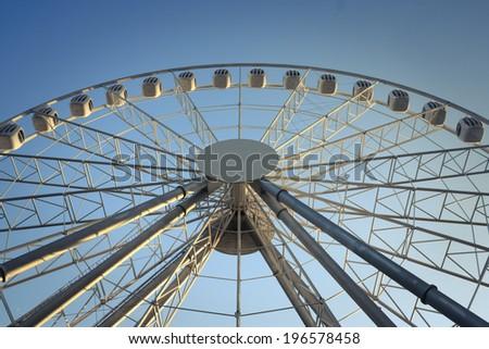 ferris wheel against a blue sky background - stock photo