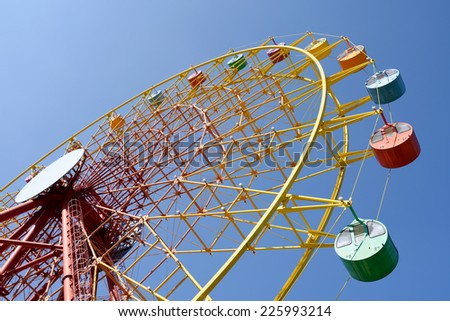 Ferris wheel against a clear blue sky
