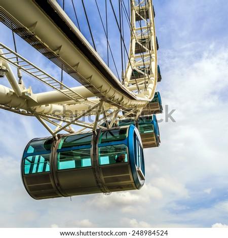 Ferris wheel and blue sky - stock photo
