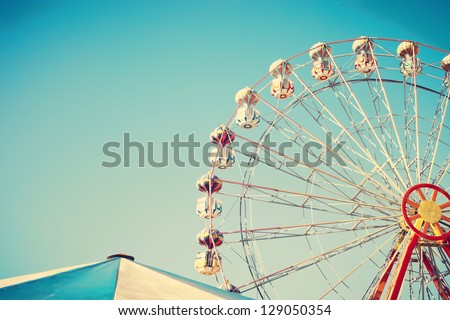 Ferris Wheel and Carnival Tent - stock photo